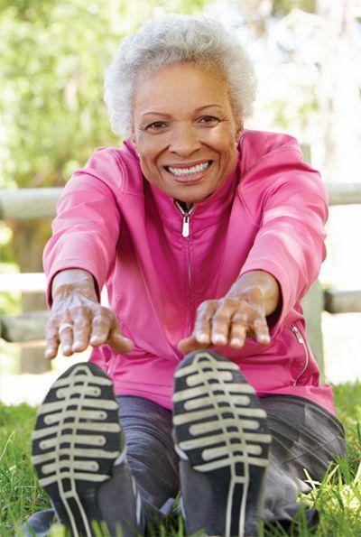 Active senior lady stretching.