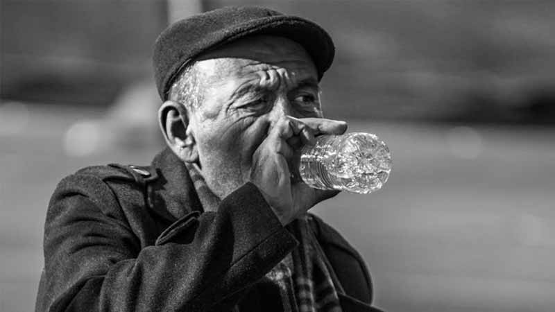Older man drinking water