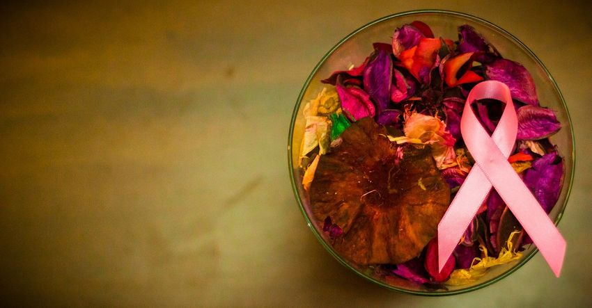Pink ribbon in bowl of potpourri