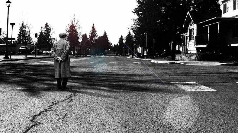 Person standing in empty street