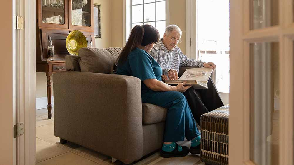 Caregiver reading to senior