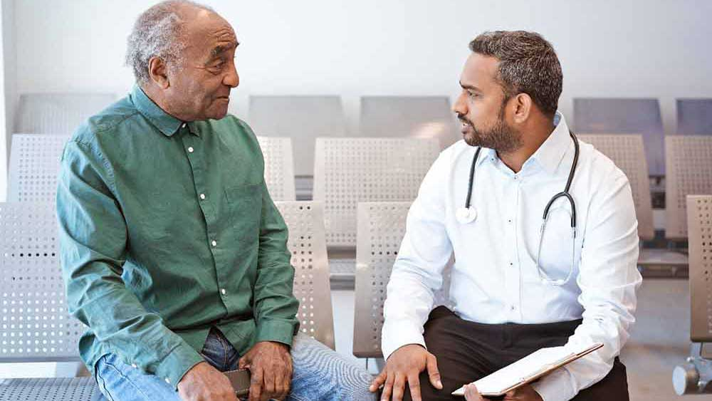 senior at consultation with doctor