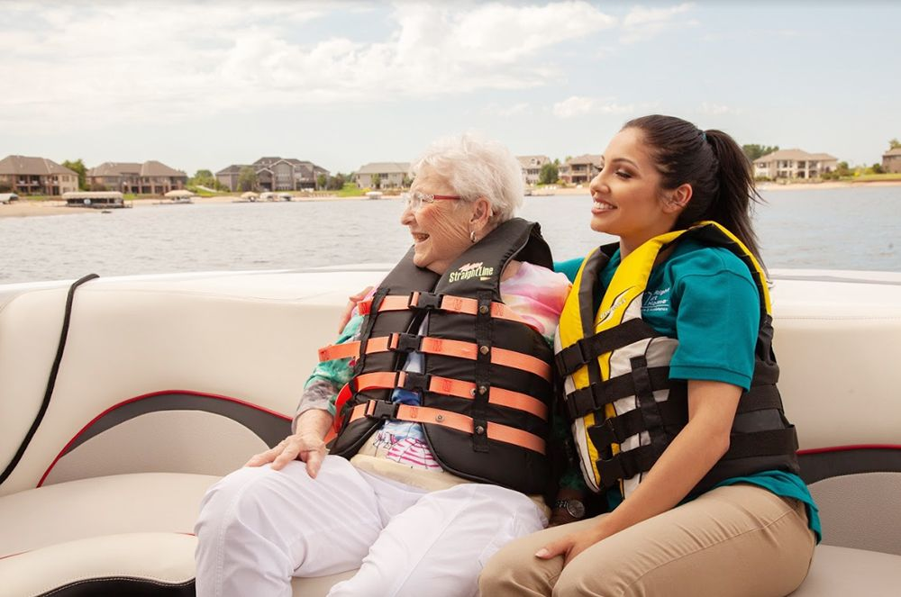 Caregiver and senior client on boat ride