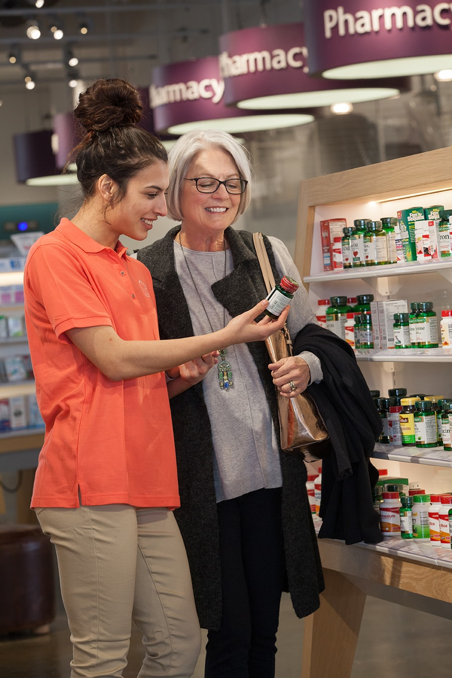 Caregiver assists senior at pharmacy