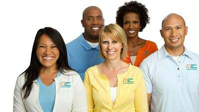 Group Photo of Multiple Caregivers Wearing Right at Home Sweaters