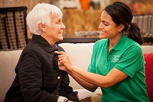 Caregiver helping groom senior