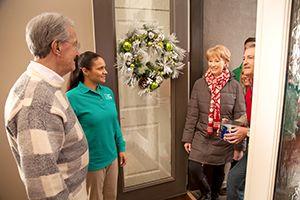 Caregiver assisting senior during holidays