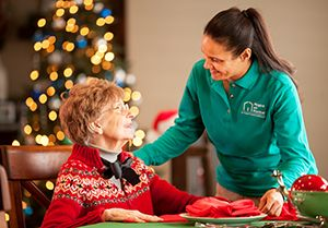 Caregiver assisting senior during holidays