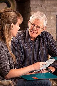 Adult child talking to parent about in-home care