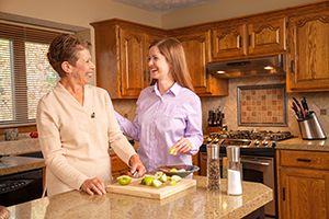Caregiver helping prepare meal