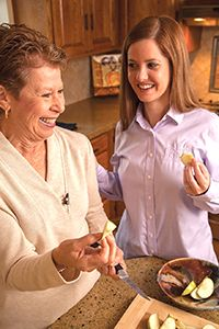 Caregiver helping prepare meal