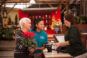 Caregiver helping senior to shop