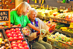 Caregiver helping senior to shop