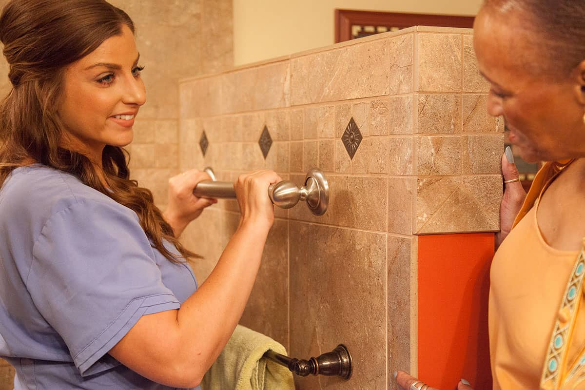 Caregiver gripping shower bar