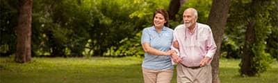 Senior and caregiver on a walk
