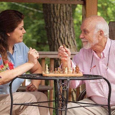 Caregiver outside with senior