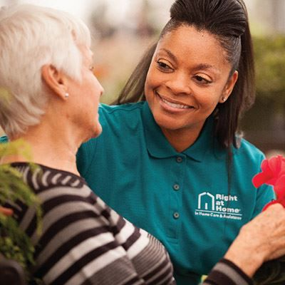 caregiver outside with senior