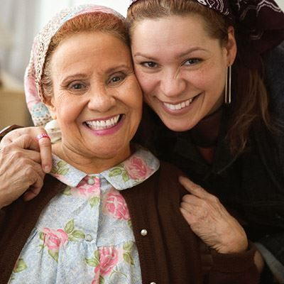 Happy caregiver with happy senior