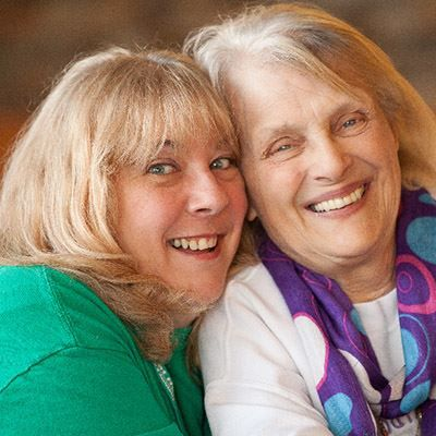 Caregiver smiling with Senior