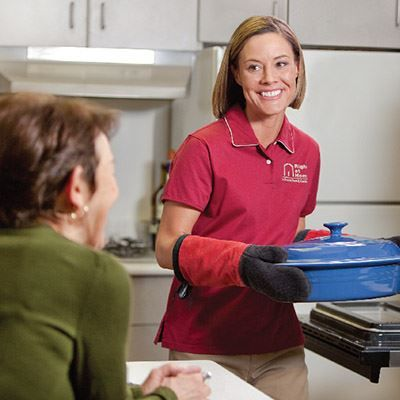 Caregiver assisting in cooking