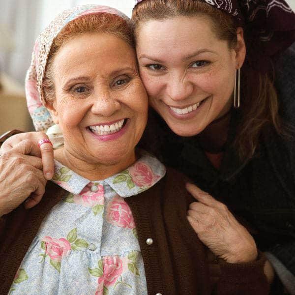Happy caregiver with Senior