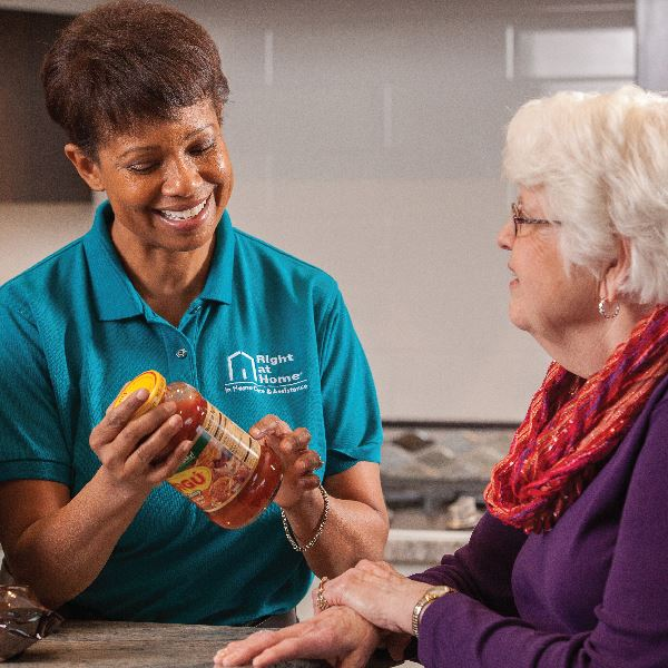 Caregiver looking over food label with senior