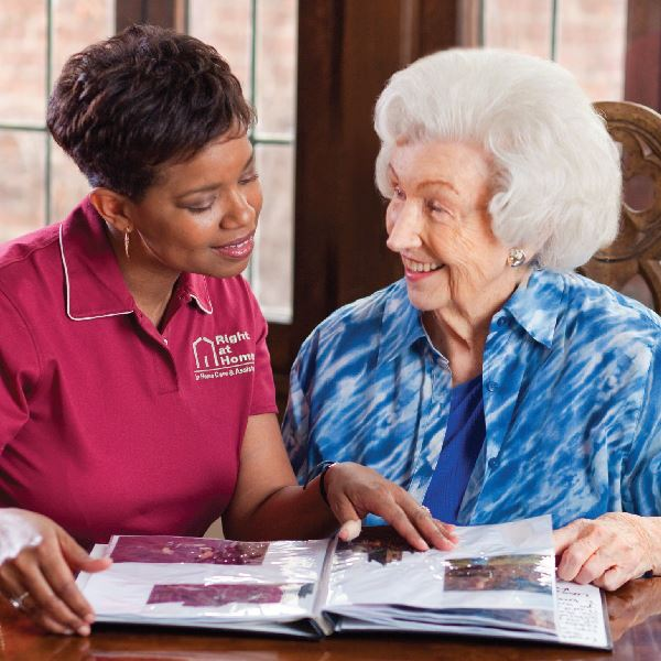 caregiver reading with senior