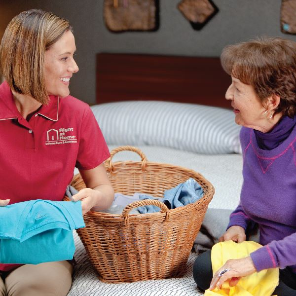 caregiver assisting with laundry
