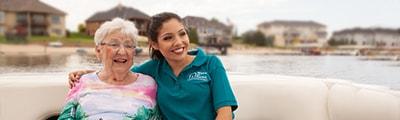 Caregiver in boat with senior