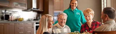 family at table with caregiver