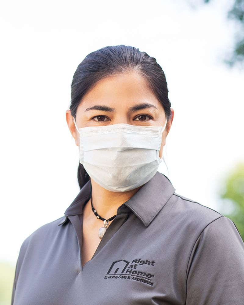 Right at Home Caregiver wearing PPE - 800x1000