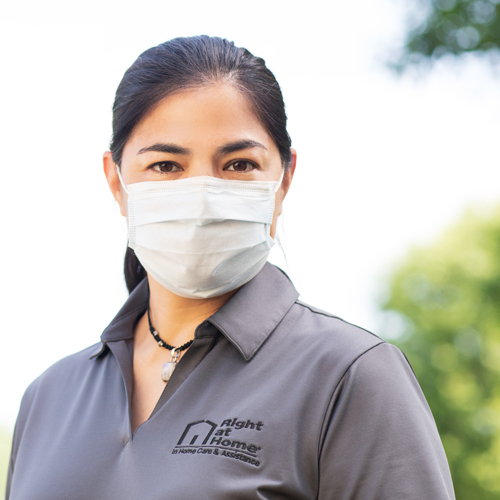 Right at Home caregiver wearing PPE