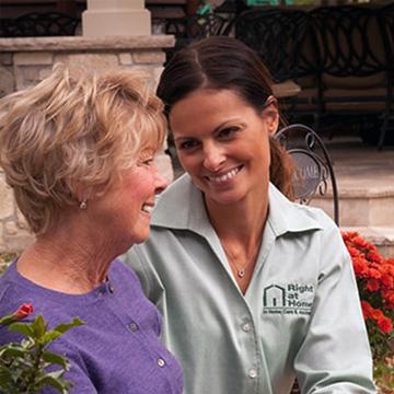 Caregiver Serving a Meal to a Senior Client