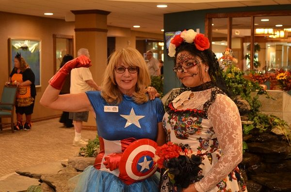 Right at Home Sarasota Staff Member Cyndi Marino with Costumed Caregiver at Stone River RLC Halloween 2018