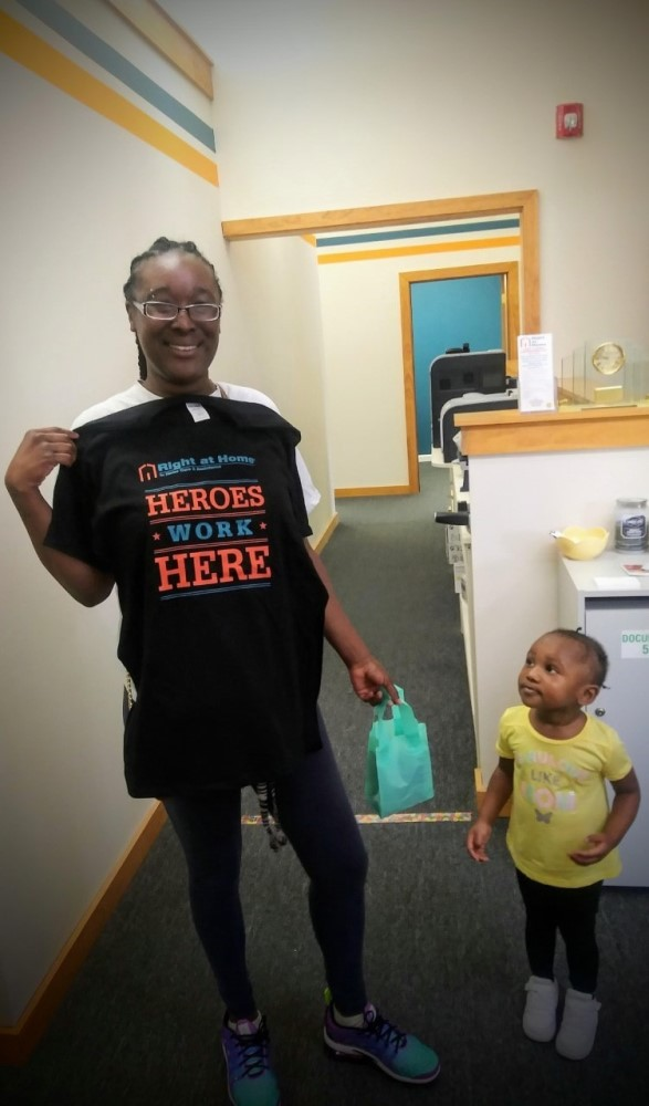 A child looks up to a caregiver hero.