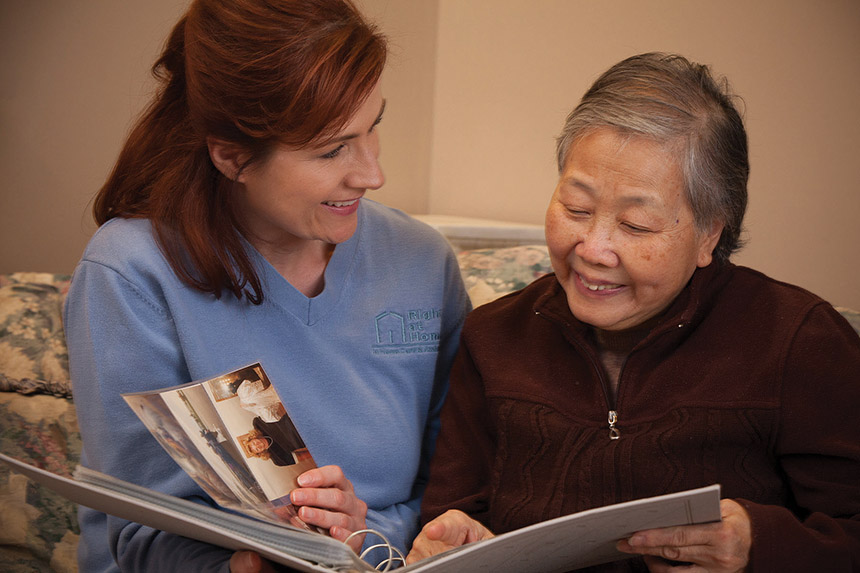 caregiver and senior reading book