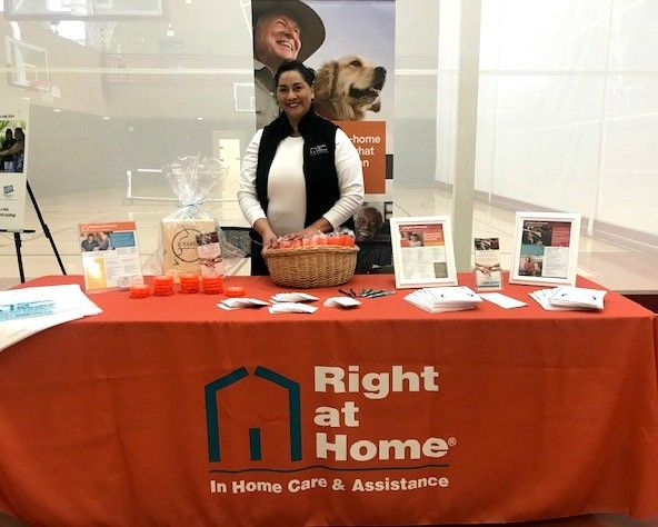 Woman behind Right at Home booth at Active Living Fair