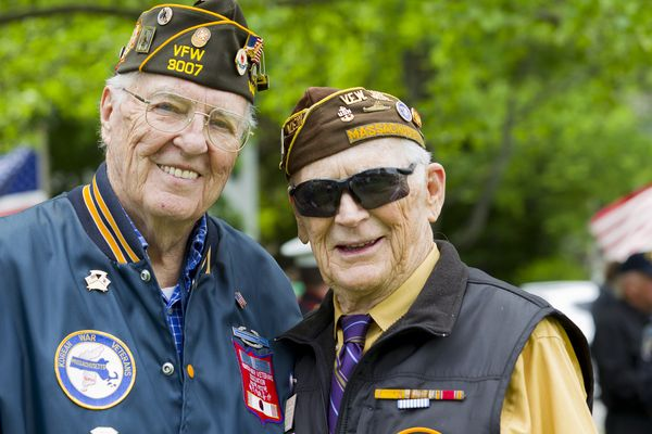 Two veterans standing next to each other