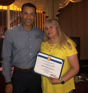 Right at Home Durham Chapel Hill owner Ken Helmuth posing with Durham Chapel Hill caregiver Hero of the Quarter Salome