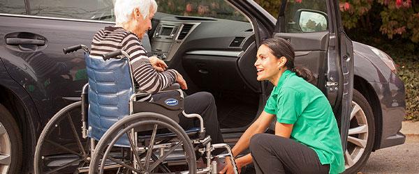 Caregiver Helping Client in Wheelchair