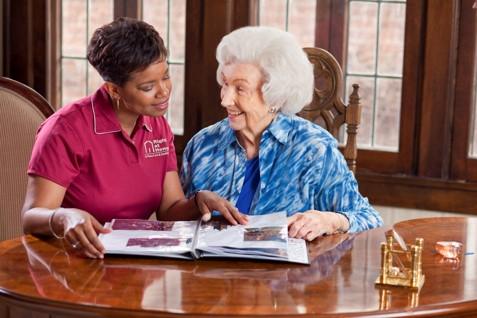 Caregiver Looking at Photo Album