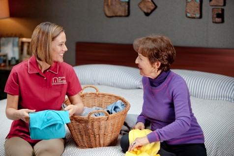 Caregiver Folding Laundry