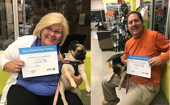 Lori Bochat and Doug Bochat show certificates dogs Thelma and Louise earned at positive pet training at Petco Woodstock