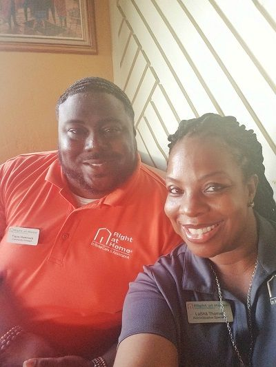 Right at Home Administrative Specialist LaSha Thomas and Community Outreach Contact Travis Hammock at Healthcare Industry Night in Stockbridge