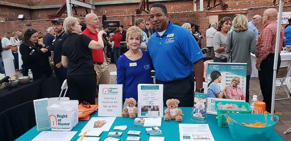 Mark Ross and Francine Oglesby from Right at Home of East Atlanta at Taste of Newton 2018