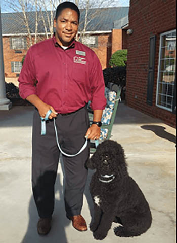 Myla the Therapy Dog from Right at Home East Atlanta, out on a client visit