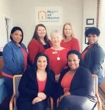 Staff of Right at Home in Covington Georgia Posing in Red Clothes for American Heart Month 2019