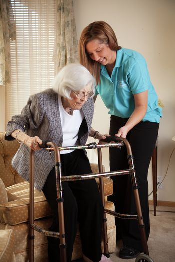 Caregiver helping senior up