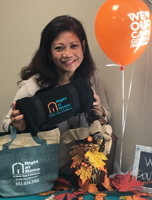 Showing off Right at Home Caregiver Swag