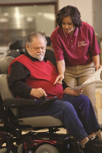client in wheelchair with caregiver